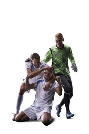 celebrate: Soccer players  celebrate the victory isolated on the white Stock Photo