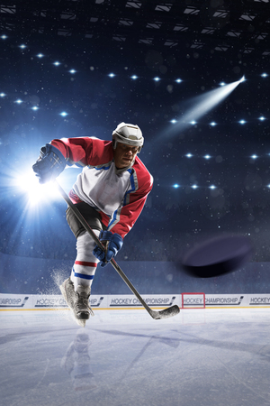 ice arena: Ice hockey player on the ice arena in lights