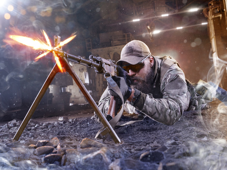 enemy: Special forces sniper is shooting the enemy from shelter Stock Photo