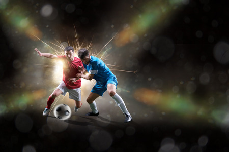 soccer player: football soccer players in action isolated on color background