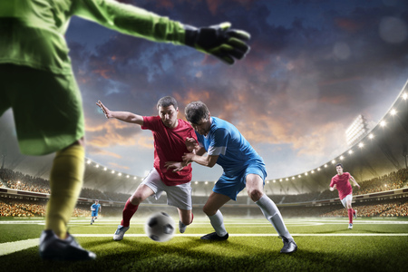 Soccer players in action on the sunset stadium background panorama Standard-Bild