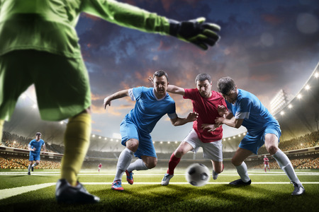 Soccer players in action on the sunset stadium background panorama Stok Fotoğraf - 57836244