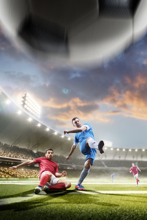 Soccer players in action on sunset stadium background panorama Banco de Imagens - 57836252