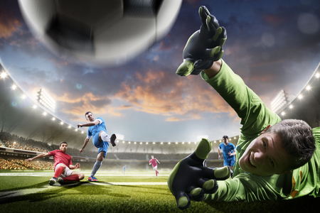 Soccer players in action on the sunset stadium background panorama Stockfoto