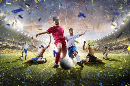 Collage from childrens soccer players in action on the stadium background panorama Stockfoto