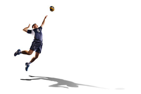 Professional valleyball player in action isolated on white Standard-Bild