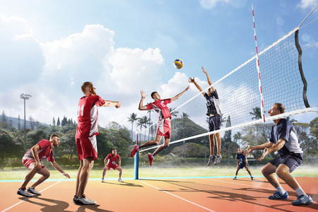 Professional volleyball players in action on the open air court Stock Photo - 62481645
