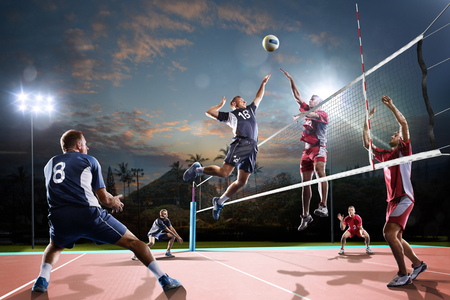 Professional volleyball players in action on the open air court