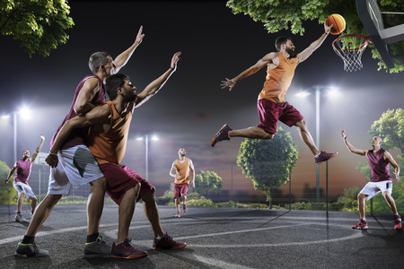 Streetball players in action on night court Stok Fotoğraf - 65839162