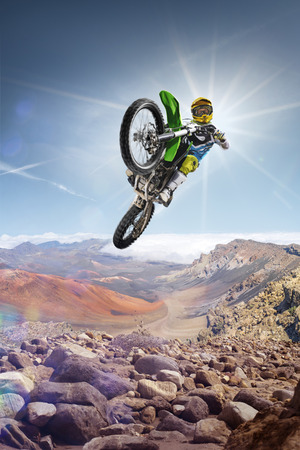 motorsprot: Dirt bike rider is flying high on the top of the vulcan