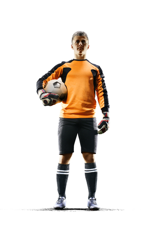 Portero de fútbol profesional en la acción sobre fondo blanco Foto de archivo - 75387950