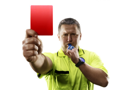 Professional soccer referee giving the red card isolated
