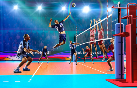 Professional volleyball players in action on the colour grand court Фото со стока