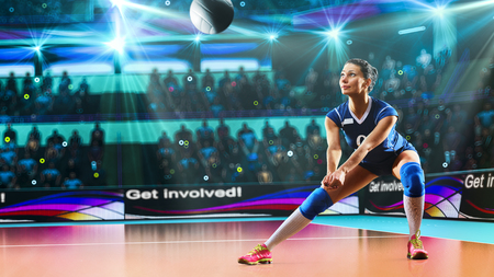 Female professional volleyball player on grand court Imagens