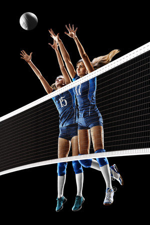 Female professional volleyball players isolated on black Stock Photo