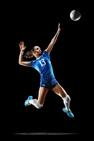 黒に分離された女性プロのバレーボール選手 写真素材