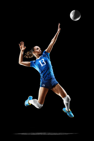 Female professional volleyball player isolated on black Imagens - 82856502