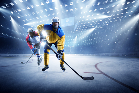 Ice hockey players on the grand ice arena Stock Photo