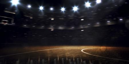 暗いスポットライトのグランドバスケットボールアリーナ 写真素材