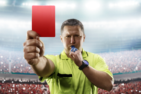 Referee showing the red card in the soccer stadium Stock Photo