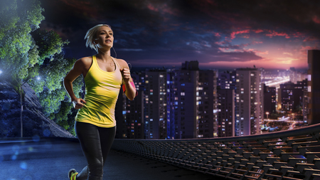 Woman running outdoors on the night town