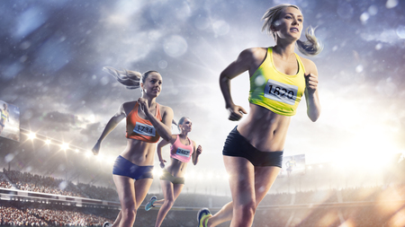 Three professional female runners at grand arena Stockfoto