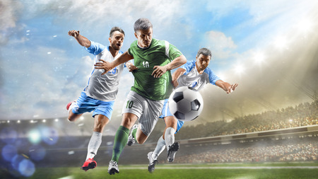 Soccer players in action on grand stadium background panorama