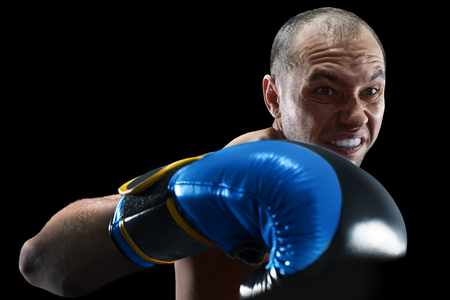 professional boxer isolated in black background dark