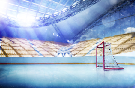 ice hockey stadium with lights crowd and an empty ice rink