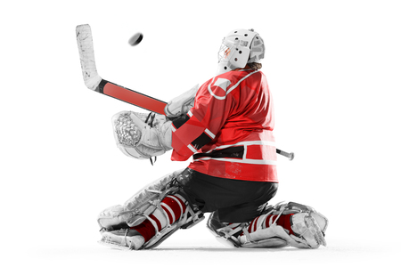Professional ice hockey player goalkeeper in action on white backgound Stock Photo