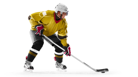 Professional ice hockey player in action on white backgound