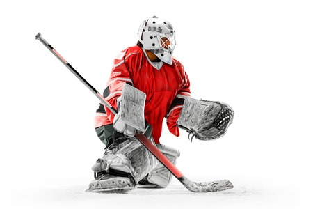 Professional ice hockey player goalkeeper in action on white backgound