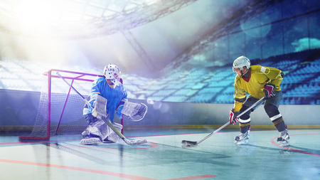 Professional hockey players in action on grand arena 스톡 콘텐츠