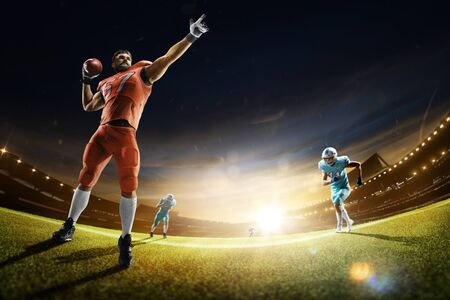 american football players in the action grand arena 스톡 콘텐츠