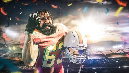 American football sportsman player on stadium in action Stock Photo