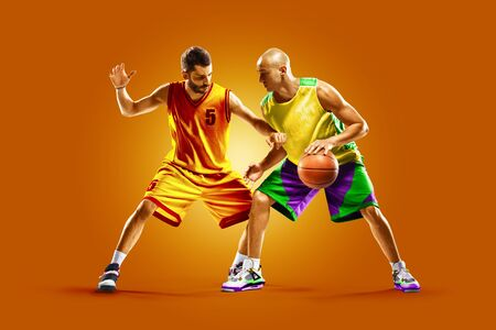 colourful professional basketball players isolated over orange background Banco de Imagens