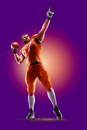 colourful professional american football player isolated over purple background