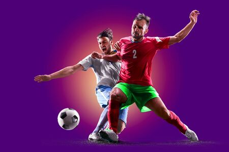 colourful professional soccer players isolated over purple background
