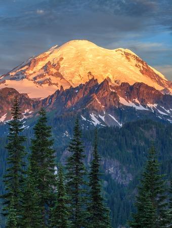 Mount Rainier at sunrise in Mount Rainier National Park, Washington, USA Stock Photo