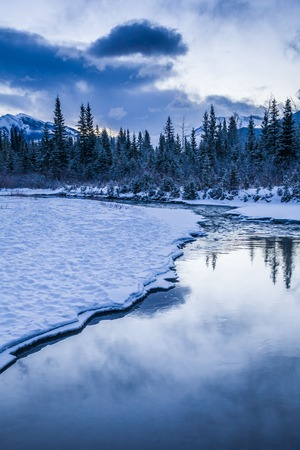 canmore: Early morning at a creek near Canmore, Alberta, Canada at on cold winter day.