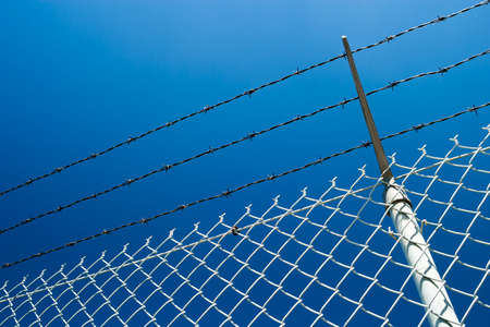 Chainlink fence and the blue sky Stock Photo