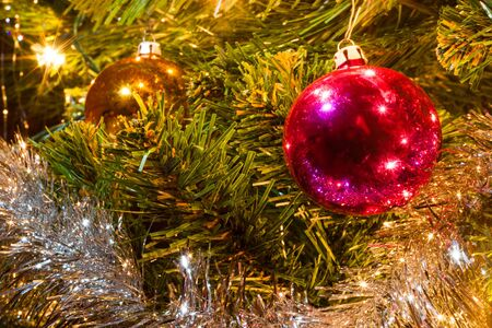 Christmas decorations hanging on a christmas tree