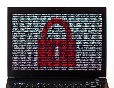 Red lock over encrypted text on a laptop screen against a white background - cyber crime