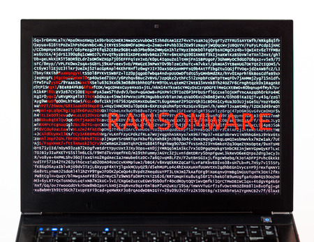 Ransomware text with red lock over encrypted text on a laptop screen against a white background - cyber crime