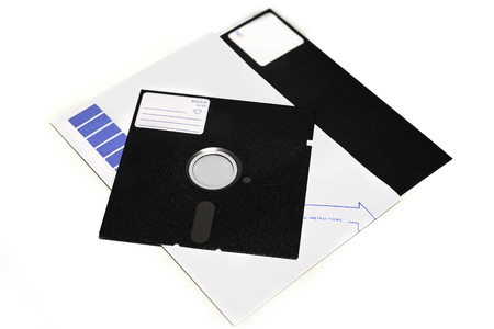 Old 5.25 and 8 inch floppy disks isolated on white background