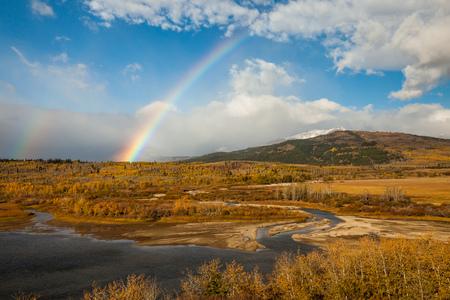 Rainbow on an autumn day near Saint Mary, Glacier National Park,