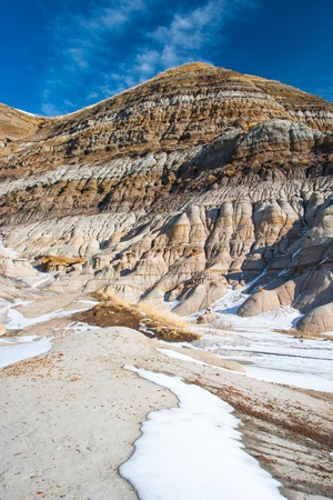 The badlands near Drumheller, Alberta are famous for rich deposi