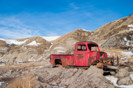 Old, abandoned car in the Drumheller badlands