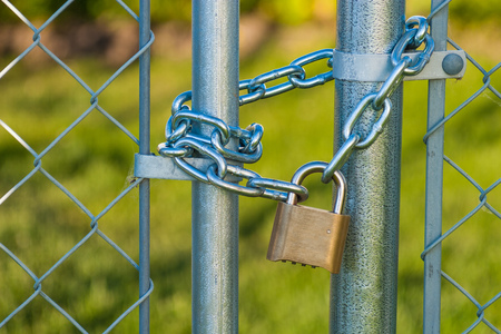 Chain and lock on a chainlink fence Stock Photo