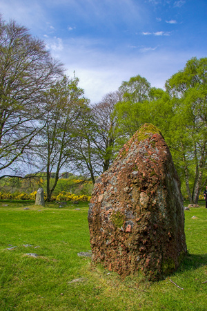 Standing stone and cairn at Clava Cairn in Scotland